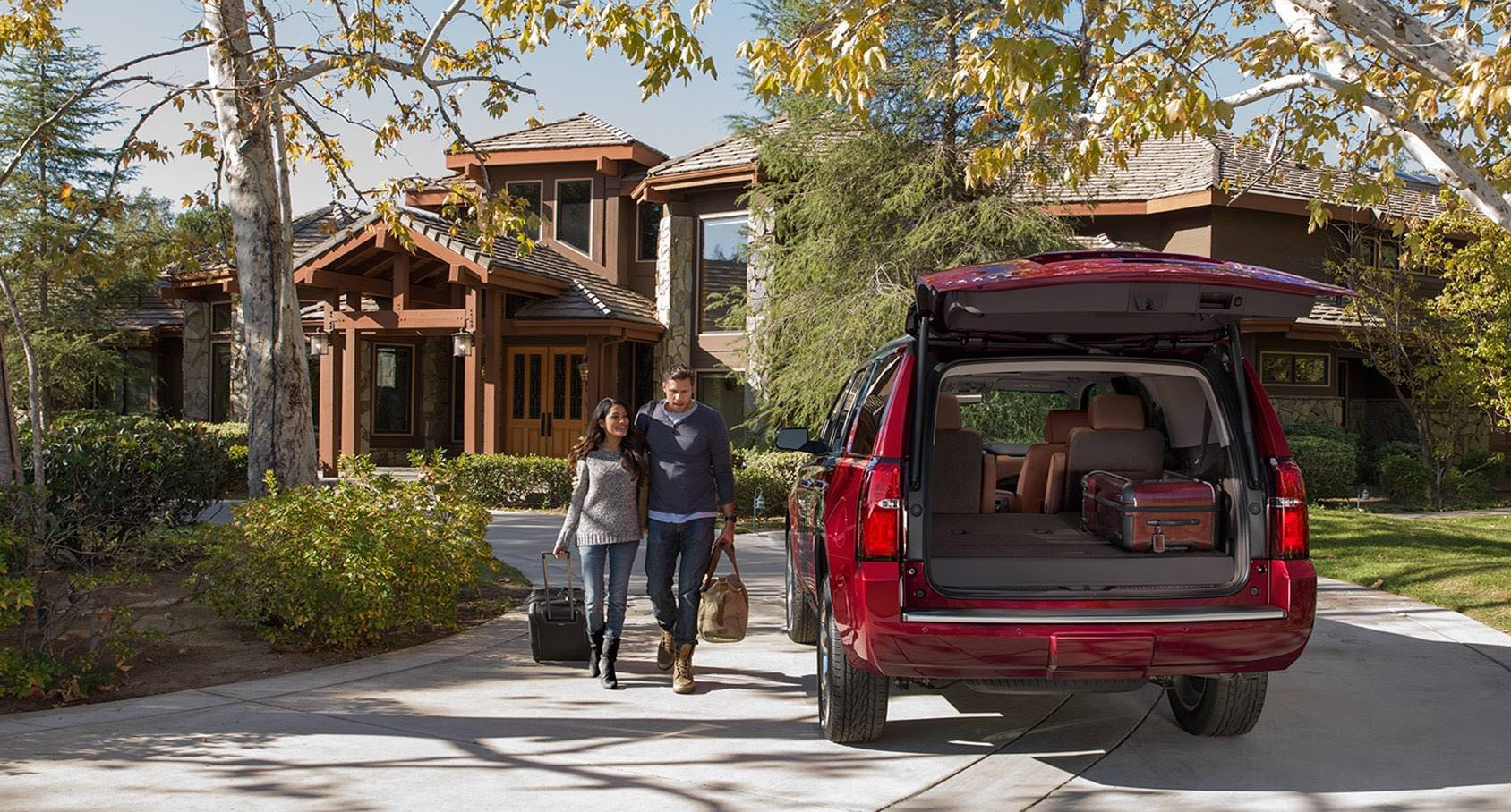 Valley Chevy - Man Buying New Chevrolet Vehicle: Tahoe Family SUV